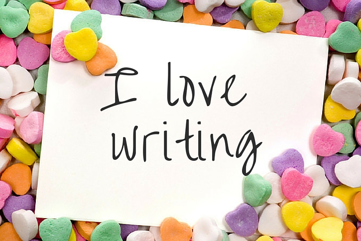 "A card that says ""I love writing"" among candy hearts"