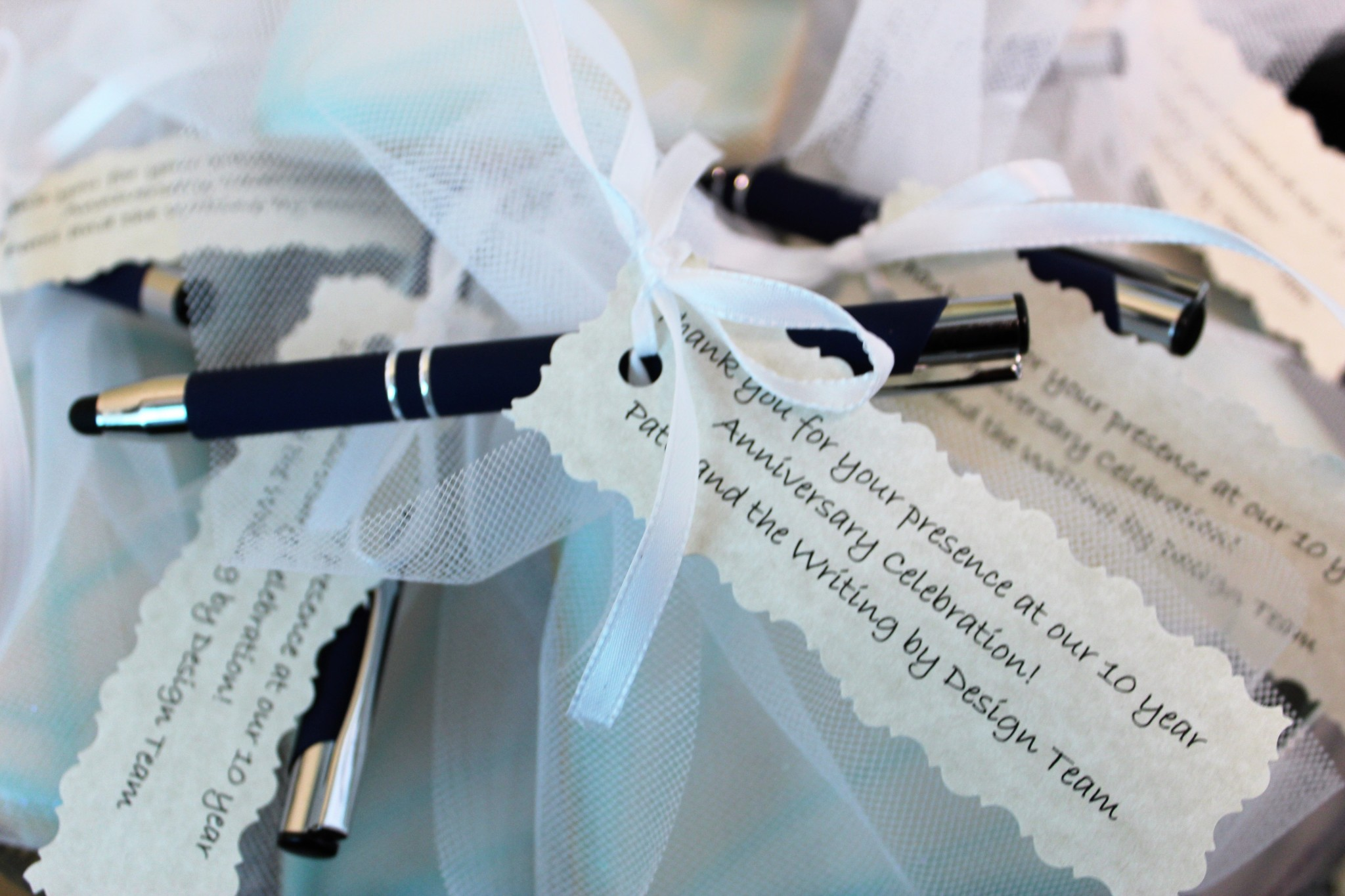 Photo of a pen with note at the Writing by Design 10-year anniversary celebration