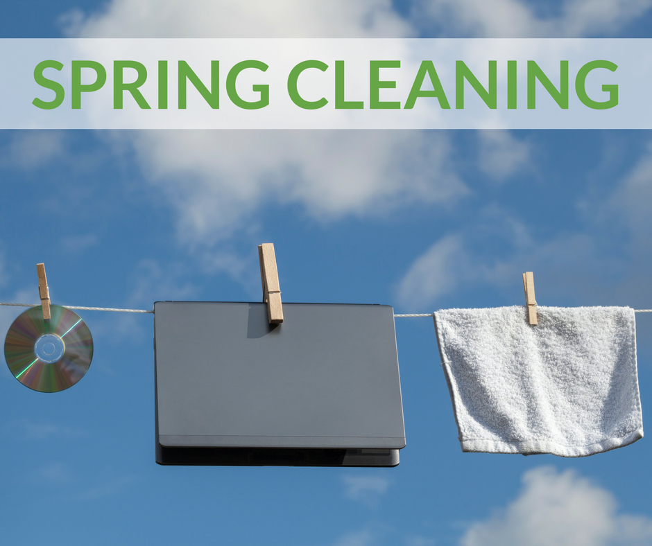 Image of a computer, CD and white towel on a clothes line with a blue sky in the background and the words spring cleaning