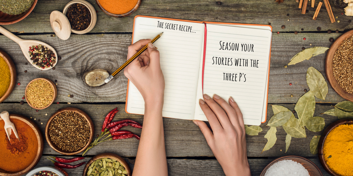 """Photo of a woman's hand writing in a notebook on a table filled with seasonings. The notebook says, """"The secret recipe: season your writing with the three P's"""""""